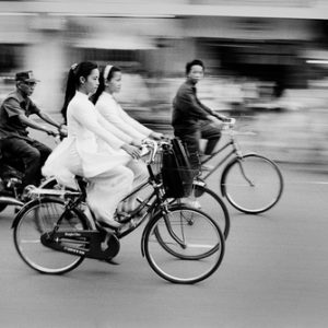 Saigon's motorbike craze is one of the heralds of the Vietnam's cultural and economic rejuvenation.  The morning commute finds young schoolgirls dressed in the traditional Ao Dai. Pre-communist fashions have made a big comeback since the late 1980s when the government began to loosen restrictions.